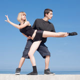 Late teenagers dancing outdoors Royalty Free Stock Image