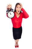 Late on Time. Business Woman in red holding a clock showing 5 to 12, is late on time, forgot something  Isolated on White Royalty Free Stock Image