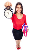 Late on Time. Business Woman in red holding a clock showing 5 to 12 with present, is late on time for shopping Isolated on White Stock Image