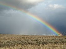 Late winter rainbow. End of rainstorm rainbow with hints of two more rainbows above and below. Taken in Northern Utah Stock Image