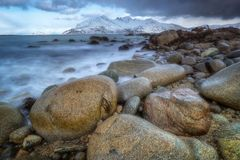 Late winter stone beach at norh of Norway Royalty Free Stock Images