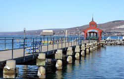 Late winter stroll on the boardwalk on Seneca Lake harbor. Showing the Seneca Lake dock after winter storm Stella. One of the Finger Lakes of New York State. At stock image