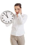 Late woman holding big clock Royalty Free Stock Photography