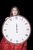 So late ! young woman with midnight clock Stock Photos