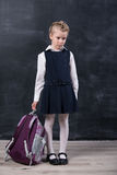 Latecomers schoolgirl near blackboard Stock Image