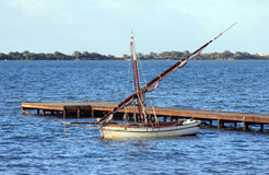 Lateen sail boat. Old boat with lateen sail moored at the quay Stock Photography