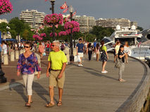 Late Afternoon Stroll. Photo of people strolling along the georgetown waterfront in washington dc on 7/25/15. This is late saturday afternoon and the light is stock photos