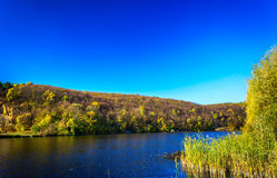 Later autumn above a quiet river. Royalty Free Stock Images