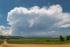 Isolated developing thunderstorm over the Black Hills in South Dakota. stock images
