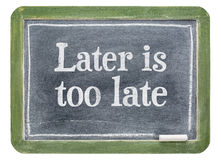 Later is too late - motivational text on blackboard. Later is too late - motivational text on a slate blackboard isolated on white Stock Photos
