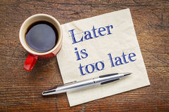 Later is too late - motivational text on napkin. With a cup of coffee Royalty Free Stock Image