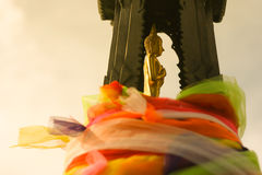 The lateral buddha sculpture on pedestal. The pedestal is arounded by colorful material, Thailand Royalty Free Stock Photos