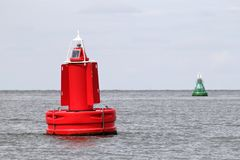 Lateral buoys. At the edge of a fairway Stock Photos