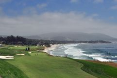 Lateral Hazard. Two golf holes along the ocean creating a lateral hazard on the right stock image