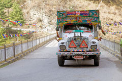 Lateral Road, Bhutan. Traditional truck along the Lateral Road, Bhutan. Bhutan's Lateral Road is a primary esat-weast corridor connecting the indian border, in stock image