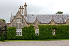 Lateral view of Muckross House, Killarney, Ireland. Muckross House, County Kerry, Ireland - is a Tudor style mansion built in 1843 located on the small Muckross Royalty Free Stock Image