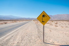 Lateral wind warning. Andean road with a sign warning of strong lateral winds Stock Photo