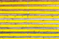 Lateral wooden planks with alternating yellow color and natural texture. Wood pattern stock photos