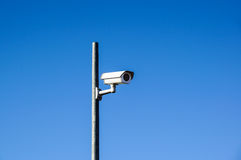 Laterally camera on a post in bue sky.  stock photography
