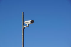 Laterally camera on a post in bue sky.  royalty free stock images