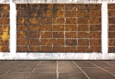 Laterite brick wall and cement  flooring. Royalty Free Stock Photo