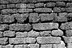 Laterite stone material monochrome greyscale. Laterite stone material monochrome at temple in Sukhothai world heritage Royalty Free Stock Images