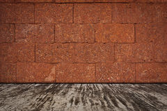 Laterite stone wall and a cement floor. Royalty Free Stock Image