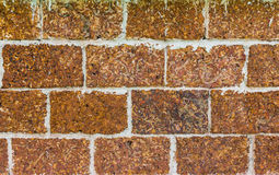 Laterite stone wall surface with cement Royalty Free Stock Photo
