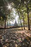 Laterite Stupa Amid Trees at Wat Pra Khaeo Kamphaeng Phet Province, Thailand Stock Photo