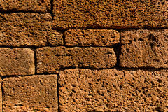 Laterite. The wall of ancient temple made from laterite Royalty Free Stock Photography