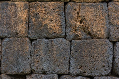 Laterite wall, pavement. Laterite stone is a favourite material for wall, pavement, walkway etc. in ancient construction in Thailand Royalty Free Stock Photos