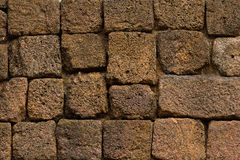 Laterite wall, pavement. Laterite stone is a favourite material for wall, pavement, walkway etc. in ancient construction in Thailand Stock Photography