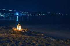 Latern on beach at night Stock Photography