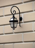 Latern on old yellow facade Stock Photography