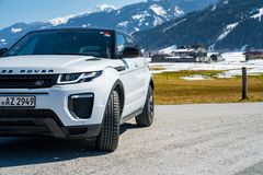 Range Rover bestselling model in the wild. Latest brand new white 2018 Range Rover Evoque. Beautiful car SUV in the nature deep in Alps royalty free stock photo