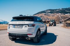 Range Rover bestselling model in the wild. Latest brand new white 2018 Range Rover Evoque. Beautiful car SUV in the nature deep in Alps royalty free stock images