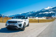 Beautiful car SUV in the nature deep in Alps. Latest brand new white 2018 Range Rover Evoque. Range Rover bestselling model in the wild stock images