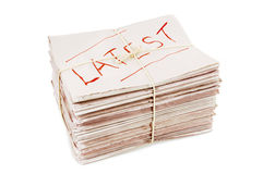 Latest edition newspapers headline stack tied with string isolated on white background Stock Photography