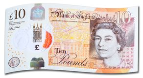New UK Ten Pound Note. Latest edition of UK plastic ten ten pound note on white background with shadow royalty free stock image
