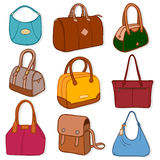 Latest fashion handbags and purses, on white Royalty Free Stock Photo