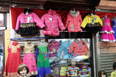 Latest Indian Childrens clothing in front of a retail cloth shop in Kolkata Stock Photos