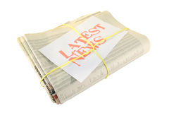 Latest news. Newspapers tied with yellow string showing latest news.Isolated on white background Stock Photo