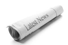 Latest News. Roll of newspapers isolated on white Royalty Free Stock Image
