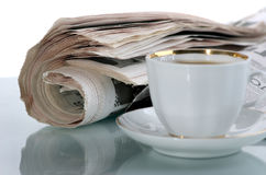 The latest news. The fresh newspaper and cup of morning coffee Stock Photo