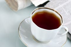 The latest news. The fresh newspaper and cup of morning coffee Royalty Free Stock Photos