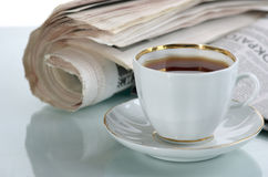 The latest news. The fresh newspaper and cup of morning coffee Royalty Free Stock Photo