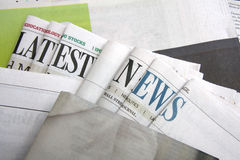 Latest news on newspapers Stock Photo