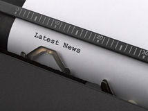 `Latest News`  message typed by vintage typewriter Stock Photos