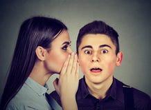 Latest rumors. Amazed man listening gossip in the ear. Latest rumors. Amazed men listening to gossip Royalty Free Stock Images
