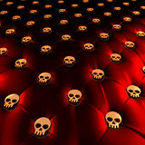 Latex chesterfield upholstery with golden skulls Stock Image